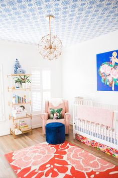 One of my best friends, Amanda, gave birth to a baby girl last month, and sweet Charlotte may have the most beautiful nurseries of all. I love how Amanda mixed the different blues, reds, and pinks - the pattern play is spot on in this stylish room. I've never seen the IKEA Hemnes overlays before and was impressed by how high-end they made the $250 dresser look!