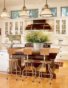 lights, stools, cow weathervane, range hood... white cabinets!!