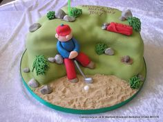 Golfing themed cake with the golfer stuck in the bunker. Finished with rocks tuffs of grass and golf bag