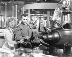 "Anne Francis with Jack Kelly in ""Forbidden Planet"" (1956)."