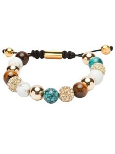 Various bead bracelet from Nialaya, featuring gold tone, tiger eye, turquoise, white marble, and clear pave crystal beads strung on a tough black nylon cord. Has gold tone fluer-de-lis beads hanging from the adjustable woven fastening. Nialaya bracelets are often made to order. Please allow 1-2 extra days for order processing.