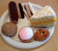 These are an assortment of my hand knitted cakes and biscuits. All available to purchase from me as barginspls on eBay