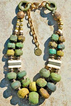 Green Hebron glass beads, terra cotta and African brass double strand necklace.  Created by Kelly Conedera.