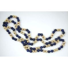 "lapis lazuli and 14k gold corrugated bead necklace, with an alternating pattern of two smooth, polished lapis beads, followed by a pair of 14k gold corrugated beads, with a total of 32 pair (64 single) 14k gold beads. The gold beads provide a rich and wonderful contrast to the deep blue lapis with flecks of pyrite that add a visual zing. Both the 14k gold and lapis beads measure 6 mm and are hand-knotted, forming a continuous single strand. Necklace measures 30""."