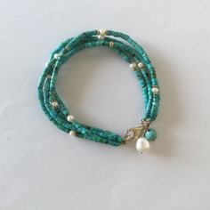 Turquoise and pearls charms bracelet