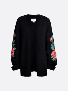 Loose fit knitted cardigan. Wide sleeves with onsewn embroided roses. Open front. The model is 175 cm and is wearing size S. Bik Bok X Elsa Hosk.  Musta