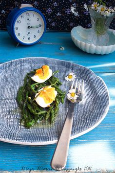 Wild asparagus salad - Cook asparagus until crisp-tender, then drain. Place in a shallow dish; top with domestic olive oil and boiled egg.  Delicious!