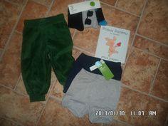 Vaatteita ja kirja pojille
