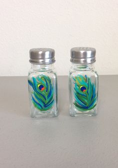 Hand painted salt and pepper shaker set.     Hand wash with soap and water. I use a special non-toxic glass paint that is heat set for lasting durability. Each glass is different as it is painted by hand.