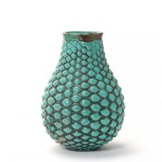 Terracotta vase modelled in budded style. Decorated with turquoise green glaze, upper part with reddih brown elements. Indistinct signature. Made and stamped by P. Ipsens Enke, Denmark. H. 22,5 cm.
