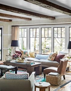 In designer Thom Filicia's lake house, the living room's Skaneateles sofa by Vanguard has a low back, so it doesn't block views of its namesake upstate New York lake.   - HouseBeautiful.com