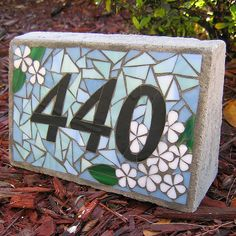 """Stained glass and poured concrete house number 'brick'. About 8"""" wide, 5"""" tall and 1.3-2.75"""" deep."""