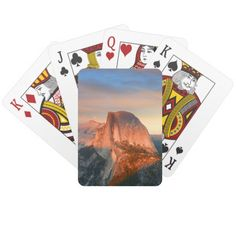 Sunset Over Half Dome Yosemite Blue And Orange VTC Poker Deck This custom gift features nature travel photography from the beautiful Yosemite National Park, CA USA during sunset with orange clouds swirling in the background and the iconic landmark Half Dome in the foreground. Great gift for a hiker, rock climber, outdoorsman, mountain or park lover. Image info vertical photo, blue, orange, grey black.