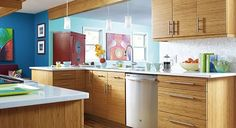 Bamboo Decorá #cabinets and bright accent colors make this modern #kitchen remodel a total success!
