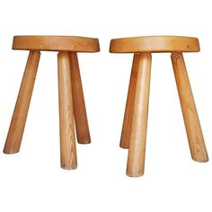 For Sale on 1stdibs - Pair of Charlotte Perriand stool from 1966 in Bois D'Arolle. Arolle wooden stool with thick circular seat resting on 3 feet Rodin type. 45 x 31 cm. Provenance