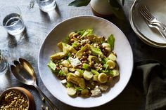 pantry salad made from canned artichokes, hearts of palm, white beans, celery, feta, and toasted pine nuts