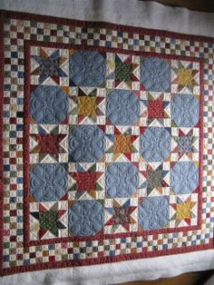 Stars and checkerboard squares quilt - nice block design