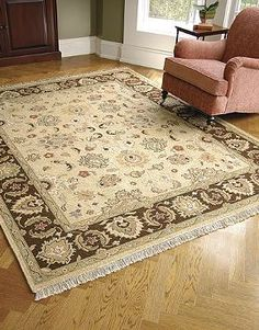Offering beauty and comfort underfoot, the Java Sumak Wool Area Rug is hand-knotted, inspired by ancient Persian deigns and sure to draw attention in any room.