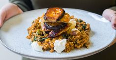 Fried aubergine and halloumi flavoured with delicious harissa are piled high on top of a stack of freekeh. Freekeh is our new fave ingredient. It's got a nutty texture that's simply perfect to accompany midweek meals. The finished dish is drizzled with honey for a mouth watering result.