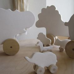 Love this menagerie of wheeled animals.... from Paloma's Nest.