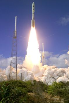 New Horizons to Pluto liftoff via the mighty Atlas V, January 19, 2006 @ Cape Canaveral. Rendezvous with Pluto July 2015. Fastest spacecraft ever travelling 58,536 km/h relative to The Sun at fastest, nearly 40 km/sec.