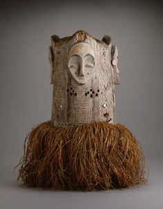Africa   Four faced helmet mask from the Fang people of Gabon   Wood, raffia, pigment and mirrors   ca. 20th century