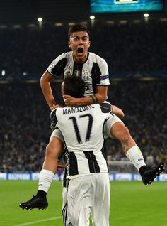 Paulo Dybala of Juventus celebrates with Mario Mandzukic after scoring a goal during the UEFA Champions League Quarter Final first leg match between Juventus and FC Barcelona at Juventus Stadium on April 11, 2017 in Turin, Italy.
