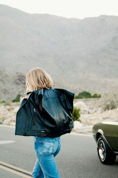 Layer a classic leather jacket over vintage Levi's jeans, like @taylranne.