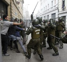 Riot police hit students with their batons during a national strike at Santiago August 2011 Riot Police, Special Forces, Law Enforcement, South America, Action, Military, August 25, Prussia, Revolution