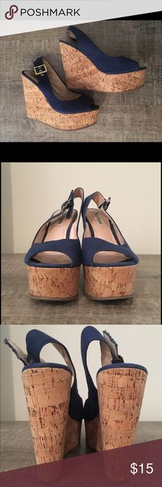 Steve Madden Wedges Navy peeptoe cork wedges by Steve Madden. V comfy. Only worn a few times. Some slight discoloration inside on right toe box and tags (in pictures). Steve Madden Shoes Wedges