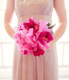 Dazzle with orchids! Radiant fuchsia cattleya orchids en masse make for a stunning bridal bouquet.