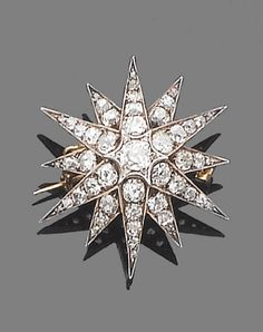 A late 19th century diamond star brooch/pendant, circa 1880.  The twelve-ray star set throughout with old brilliant-cut diamonds, mounted in silver and gold, diamonds approx. 2.60ct. total, width 3.0cm.