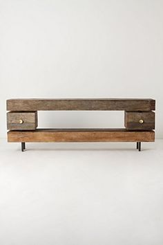 """Inspired by Italian-Modern design, this substantial two-drawer piece of unfinished, reclaimed wood stretches out in minimal sleekness"""