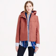"""A short solution for tricky winter outfits: We designed this jacket with front pockets and a roomy hood (you'll thank us when the wind kicks up). We made it from our favorite wool melton from Italy's Manifattura di Carmignano mill (it's known for being superwarm, hard wearing and wind resistant) and added special details to the front, like a covered zipper and pretty bib seam. <ul><li>Boxy fit.</li><li>Body length: 24 3/4"""".</li><li>Sleeve length: 33 1/4"""".</li><li>Hits at hip.</li><li>Italian…"""