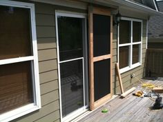 built a sliding screen door the garage journal board guides on the bottom