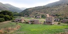 Onar-Andros-eco-resort-stone-houses-traditional-Cycladic-construction-valley-with-mountains - Greek Islands