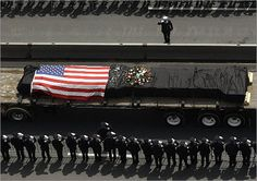 A ceremony on May 30, 2002, marked the end of the recovery and clean-up efforts and the start of rebuilding efforts. During the ceremony, the last steel beam left standing from one of the World Trade Center towers was driven away from ground zero as New York City police and fire department members saluted.