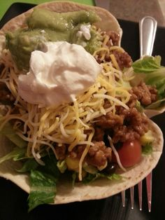 "Homemade taco salad bowls!  Low carb tortilla's pushed inside an oven safe bowl then baked at 350 for 10 minutes  Fill with lettuce,  tomatoes,  black beans,  corn,  taco meat,  Colby Jack shredded cheese,  sour cream and guacamole. Drizzle with taco sauce for ""dressing""."