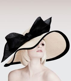 Dillon Wallwork - Natural/black pinok-pok large dip brim trimmed with large bow. #millinery #judithm #hats