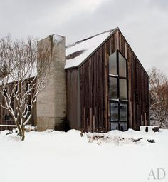 Renovated barn - only needs to have natural stone covering the cinder  block  chimney and it would be perfect
