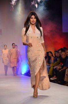Here are few pics of the vivacious and sultry siren Priyanka Chopra walking for ace designer Neeta Lulla at Lakme Fashion Week 2014.