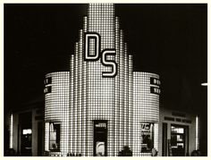 Art deco gas station in Minneapolis, Mn. made from glass blocks and lit from inside at night - circa 1937.