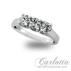 Carlotta - Lab Created Engagement Ring: Tantalizing arrangement of this stunning 3 stone ring encompassed with crossing prongs at the base. Sale Price: $606.69