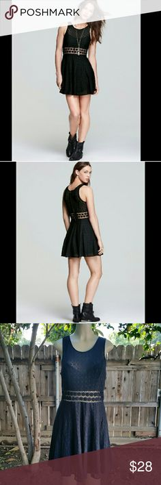 Free people daisy dress Adorable dress !! unlined panel adds flirty midriff-baring dimension and highlights cute daisies around the waist of a full-skirted frock covered in patterned knit lace. Free People Dresses Mini