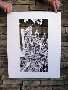 Map Papercut via Etsy: I know there are quite a few map fans on Pinterest--this one is gorgeous.  So beautiful and intricate--I'd be scared I'd rip it before I got it on the wall
