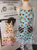 Reversible aprons Made in the USA!  Place orders at: http://www.gramsinspirations.com