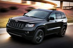 Jeep Grand Cherokee Stealth Special Edition. The Stealth is fully blacked out minus some silver trim.