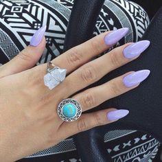 Pretty lavender almond nails. I'm kinda diggin those rings, too!