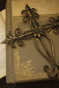 antique cross on books