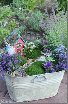 Fairy garden in a bucket now I know what to do with my bucket
